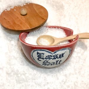 red salt cellar with wooden lid and spoon